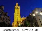 famous tower of giralda ... | Shutterstock . vector #1395015839