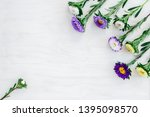 white and purple asters  on... | Shutterstock . vector #1395098570