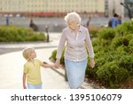 beautiful granny and her little ... | Shutterstock . vector #1395106079