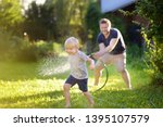 funny little boy with his... | Shutterstock . vector #1395107579