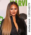 Small photo of New York, NY - April 30, 2019: Chrissy Teigen wearing Azzi & Osta attends the 2019 City Harvest Gala at Cipriani 42nd Street