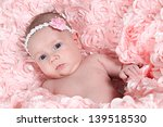 newborn baby girl in pink | Shutterstock . vector #139518530