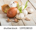 garlic and onion on wooden... | Shutterstock . vector #139528010