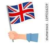 united kingdom flag in hand.... | Shutterstock .eps vector #1395316229