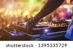 dj mixing outdoor at beach... | Shutterstock . vector #1395335729