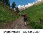 hiker on trek in caucasus... | Shutterstock . vector #1395359600