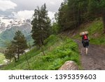 man with backpack and trekking... | Shutterstock . vector #1395359603