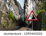 falling rocks warning sign on... | Shutterstock . vector #1395443333