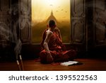 Small photo of Novice buddhist monk inside a temple in the Bagan Valley