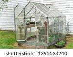 A Farmer's Green House On A...