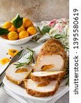 Small photo of Meat roll (roulade) with with apricot stuffing and spices on a light stone or slate background. Thanksgiving day appetizer. Copy space.