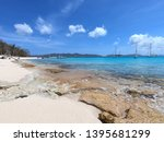 colorful beach with boats near... | Shutterstock . vector #1395681299