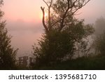 foggy morning. dawn outside the ... | Shutterstock . vector #1395681710
