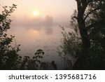 foggy morning. dawn outside the ... | Shutterstock . vector #1395681716