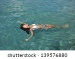 Young Woman In Bikini Floating...
