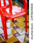 red plastic garden chairs on... | Shutterstock . vector #1395834830