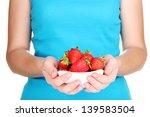 girl holding fresh strawberry... | Shutterstock . vector #139583504