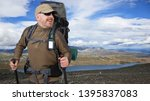 happy male tourist with... | Shutterstock . vector #1395837083