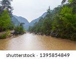 dirty river after a rain... | Shutterstock . vector #1395854849
