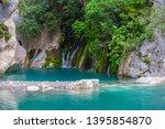 small beautiful emerald lake... | Shutterstock . vector #1395854870