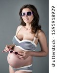 beautiful pregnant woman on a...   Shutterstock . vector #1395918929