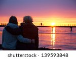 Two Couples Watching A Sunset