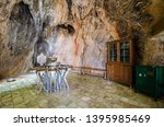 zoroastrian's shrine in cave ... | Shutterstock . vector #1395985469