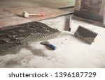 laying floor ceramic tile.... | Shutterstock . vector #1396187729