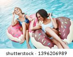 life is cool in the pool. girls ... | Shutterstock . vector #1396206989