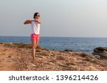 young woman doing exercises... | Shutterstock . vector #1396214426