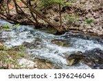 double waterfalls of... | Shutterstock . vector #1396246046