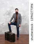 hipster traveler with baggage.... | Shutterstock . vector #1396277396