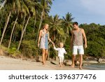 family in love on the beach... | Shutterstock . vector #1396377476