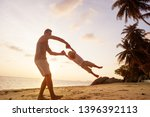 dad and son playing on the sand ... | Shutterstock . vector #1396392113