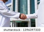 Small photo of Omani businessman giving an handshake to his business partner, Muscat