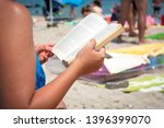 the girl reads the book on a... | Shutterstock . vector #1396399070