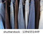 jeans hanging in closet.   image   Shutterstock . vector #1396551449