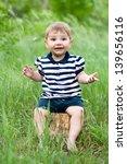 little boy sitting on a tree... | Shutterstock . vector #139656116