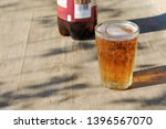 pint glass of amber pale ale... | Shutterstock . vector #1396567070