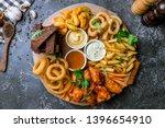 assorted beer snacks. onion... | Shutterstock . vector #1396654910