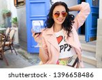 attractive young woman drinking ... | Shutterstock . vector #1396658486