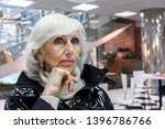 sad and pensive gray haired... | Shutterstock . vector #1396786766