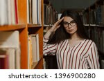 young student girl in library.... | Shutterstock . vector #1396900280