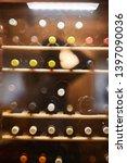 wine bottles cooling in... | Shutterstock . vector #1397090036