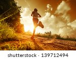 young lady running on a rural... | Shutterstock . vector #139712494