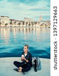 enjoying drink. young woman... | Shutterstock . vector #1397129663