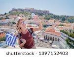 enjoying vacation in greece.... | Shutterstock . vector #1397152403