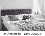 bed with pillows and plaid near ... | Shutterstock . vector #1397205236
