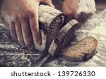 male hands slicing home made...   Shutterstock . vector #139726330
