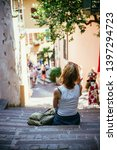 young girl is sitting on the... | Shutterstock . vector #1397294723